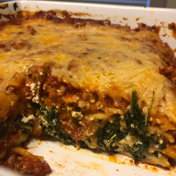 Lasagna with a slice taken out showing all the individual layers